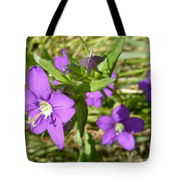 Tote Bag featuring the photograph Small Mauve Flowers by Jean Bernard Roussilhe