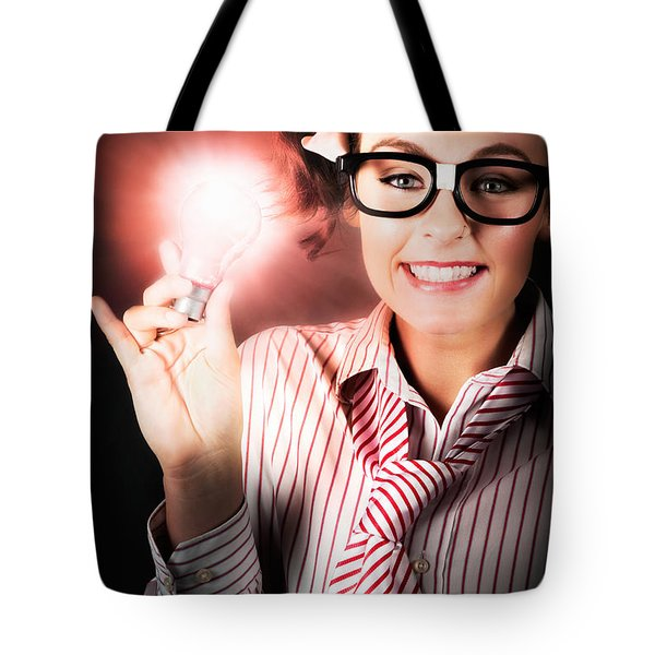 Smart Business Person Holding Light Bulb In Hand Tote Bag