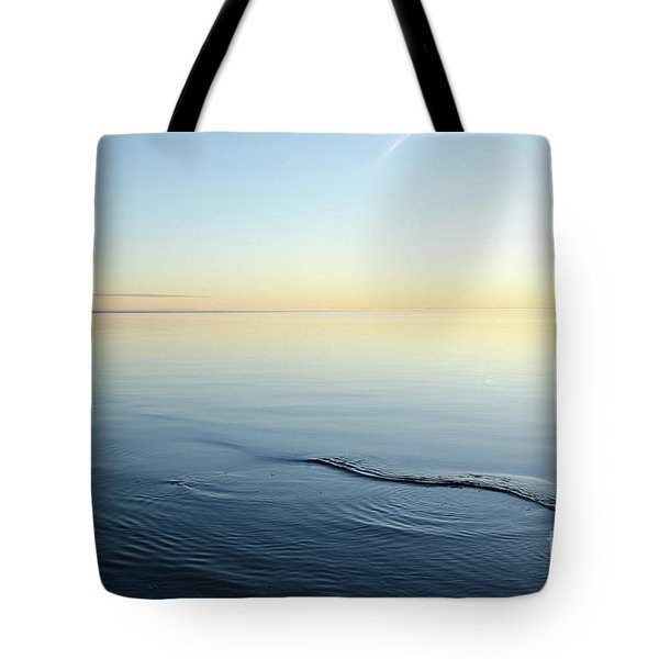 Tote Bag featuring the photograph Smooth Water And Colorful Sky by Kennerth and Birgitta Kullman