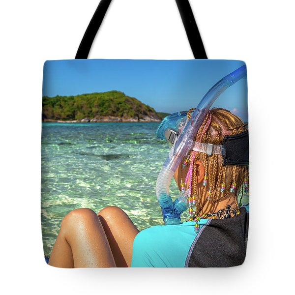 Tote Bag featuring the photograph Snorkeler Relaxing On Tropical Beach by Benny Marty