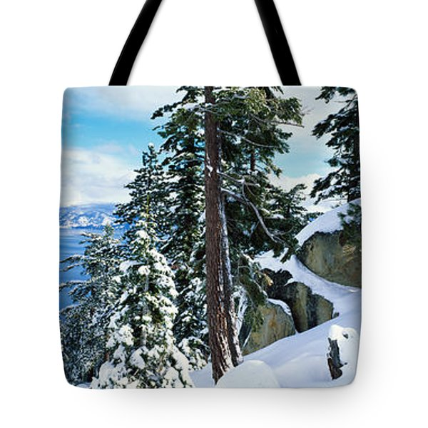 Snow Covered Trees On Mountainside Tote Bag