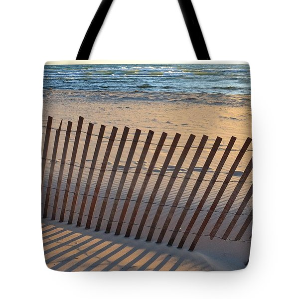 Tote Bag featuring the photograph Snow Fence On Lake Michigan by Michelle Calkins