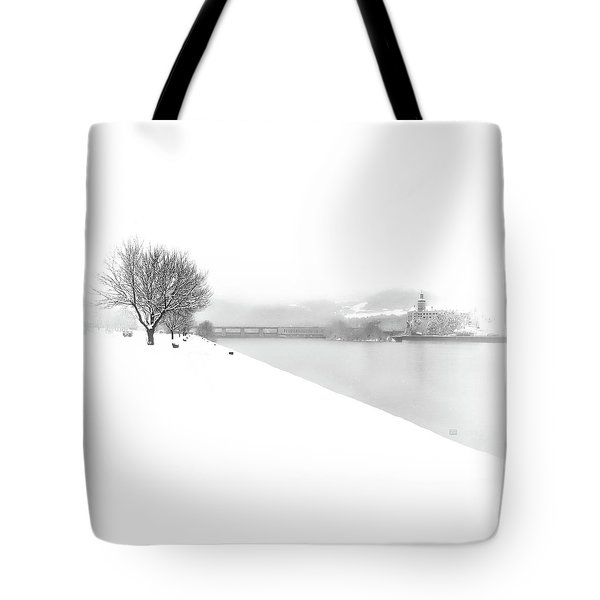 Tote Bag featuring the photograph Snowfall On The River Danube At Ybbs by Menega Sabidussi