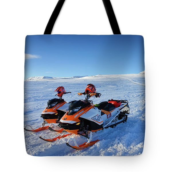 Tote Bag featuring the photograph Snowmobiles In Iceland In Winter by Matthias Hauser