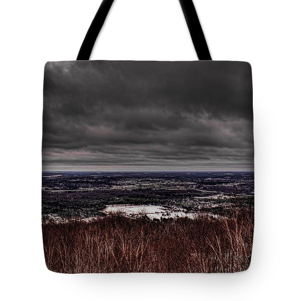 Tote Bag featuring the photograph Snowstorm Clouds Over Rib Mountain State Park by Dale Kauzlaric