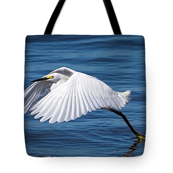 Snowy Liftoff Tote Bag