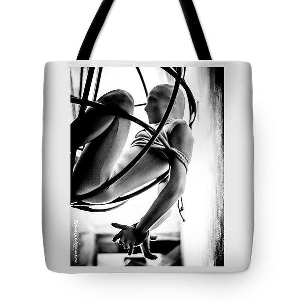 Tote Bag featuring the photograph Solar Jail by Stwayne Keubrick