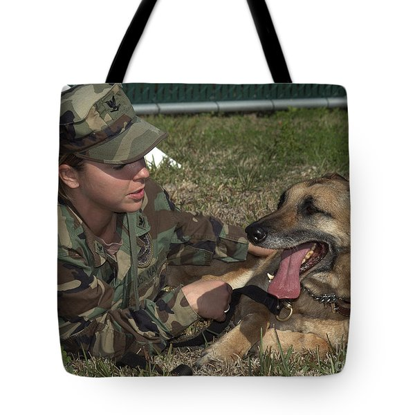 Soldier Gives Positive Reinforcement Tote Bag by Stocktrek Images