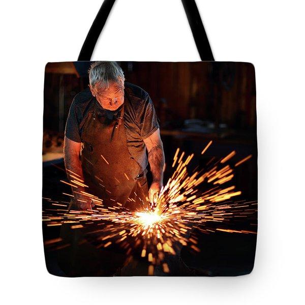Sparks When Blacksmith Hit Hot Iron Tote Bag