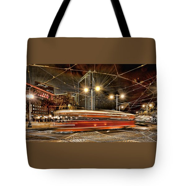 Tote Bag featuring the photograph Spinning Trolley Car by Steve Siri