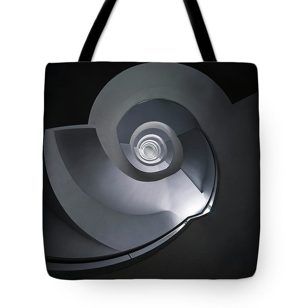 Tote Bag featuring the photograph Spiral Staircase In Grey And Blue Tones by Jaroslaw Blaminsky