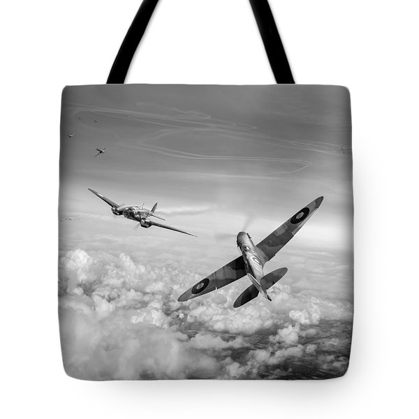 Tote Bag featuring the photograph Spitfire Attacking Heinkel Bomber Black And White Version by Gary Eason
