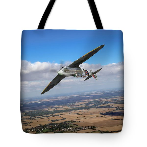 Tote Bag featuring the photograph Spitfire Tr 9 On A Roll by Gary Eason