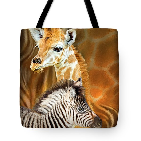 Tote Bag featuring the mixed media Spots And Stripes - Giraffe And Zebra by Carol Cavalaris