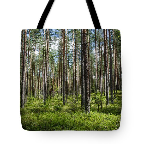 Tote Bag featuring the photograph Spring Colors In A Coniferous Forest by Kennerth and Birgitta Kullman