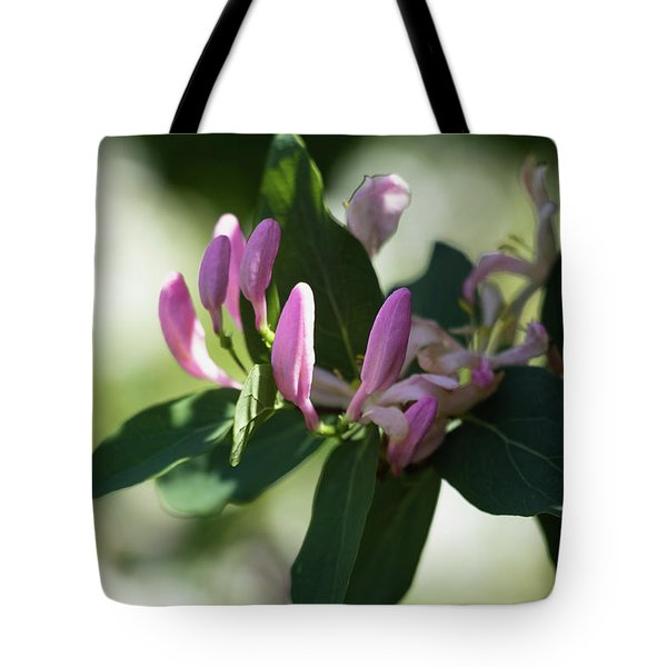 Tote Bag featuring the photograph Spring Shrub With Pink Flowers by Cristina Stefan