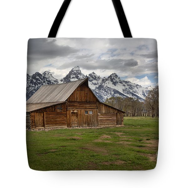 Spring Storms Over The Moulton Barn Tote Bag by Adam Jewell