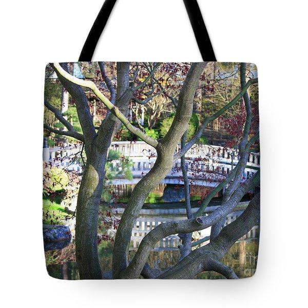 Springtime Bridge Through Japanese Maple Tree Tote Bag by Carol Groenen
