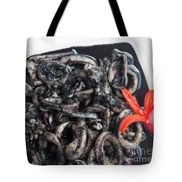 Tote Bag featuring the photograph Squid In Ink by Atiketta Sangasaeng