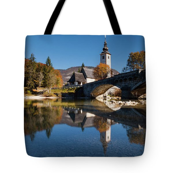 Tote Bag featuring the photograph St. John The Baptist On The Lake Bohinj by Davor Zerjav