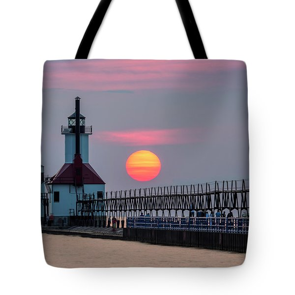 Tote Bag featuring the photograph St. Joseph Lighthouse At Sunset by Adam Romanowicz
