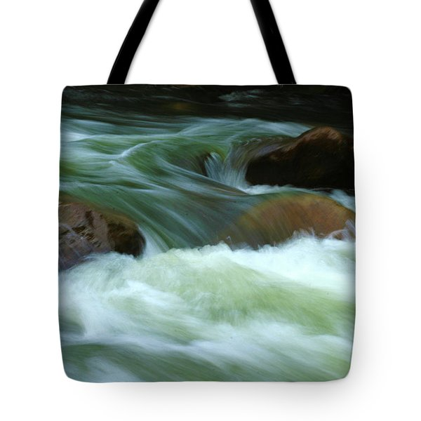Tote Bag featuring the photograph Stand Like A Rock by Marie Leslie
