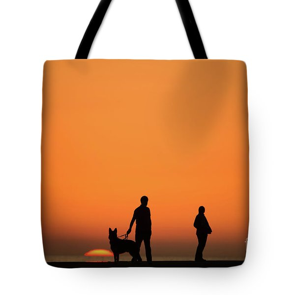 Standing At Sunset Tote Bag