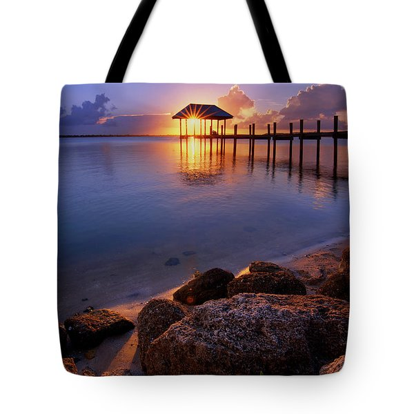 Starburst Sunset Over House Of Refuge Pier In Hutchinson Island At Jensen Beach, Fla Tote Bag by Justin Kelefas