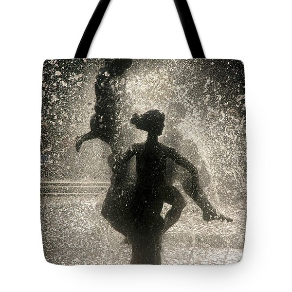 Tote Bag featuring the photograph Statue In Rostock, Germany by Jeff Burgess
