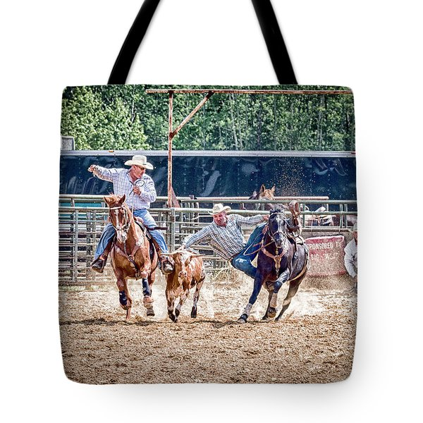 Tote Bag featuring the photograph Steer Wrestling With An Audience by Darcy Michaelchuk