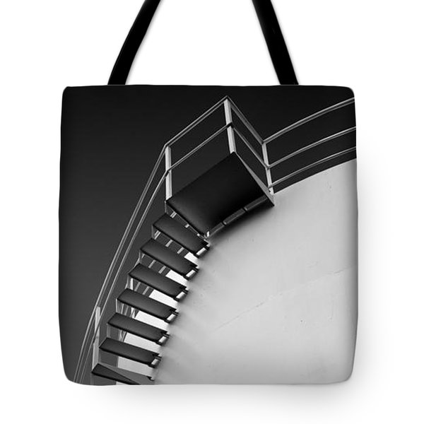 Tote Bag featuring the photograph Stepping Up by Joe Bonita