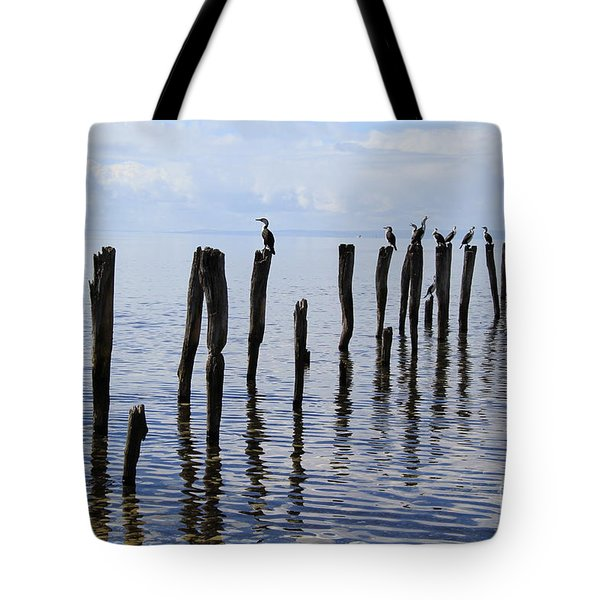 Tote Bag featuring the photograph Sticks Out To Sea by Stephen Mitchell