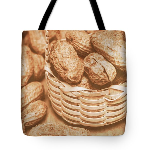 Still Life Peanuts In Small Wicker Basket On Table Tote Bag