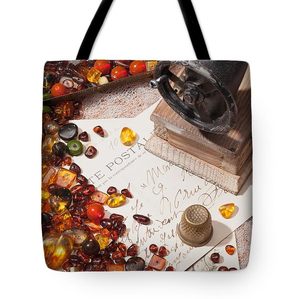 Tote Bag featuring the photograph Still-life With Amber And Sewing Machines. by Andrey  Godyaykin