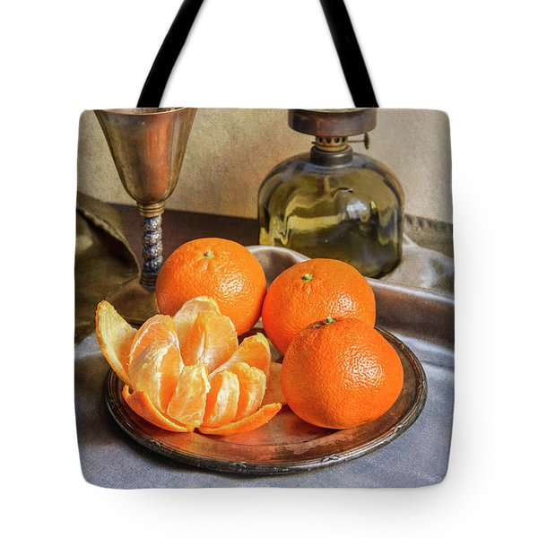Tote Bag featuring the photograph Still Life With Oil Lamp And Fresh Tangerines by Jaroslaw Blaminsky