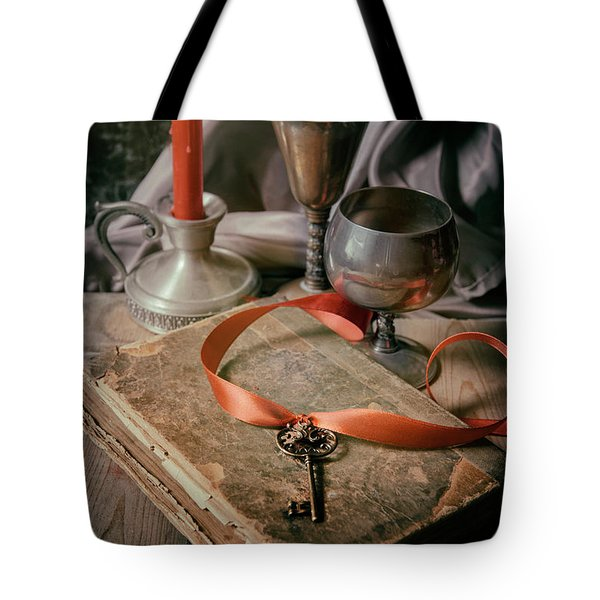 Tote Bag featuring the photograph Still Life With Old Book And Metal Dishes by Jaroslaw Blaminsky