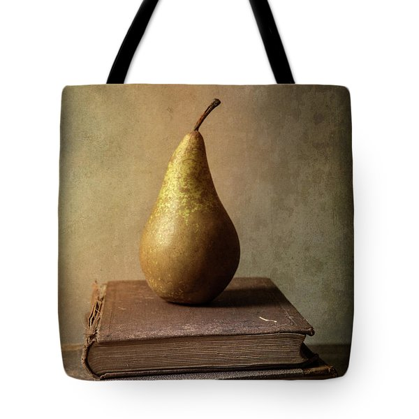 Tote Bag featuring the photograph Still Life With Old Books And Fresh Pear by Jaroslaw Blaminsky