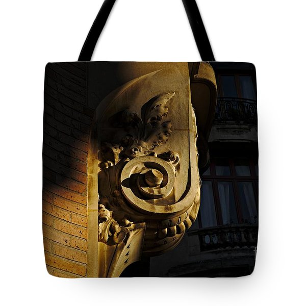 Tote Bag featuring the photograph Stone Carving by Cendrine Marrouat
