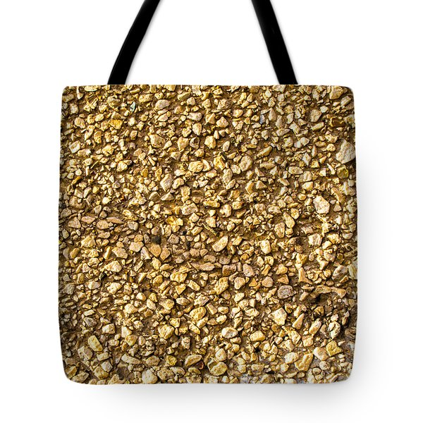 Tote Bag featuring the photograph Stone Chip On A Wall by John Williams
