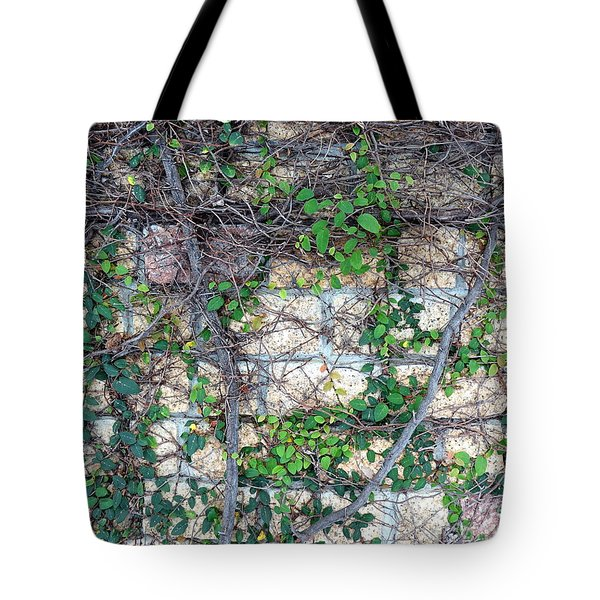 Tote Bag featuring the photograph Stone Wall Covered With Vines by Yali Shi
