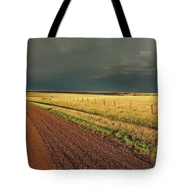 Storm Clouds Along A Saskatchewan Country Road Tote Bag by Mark Duffy
