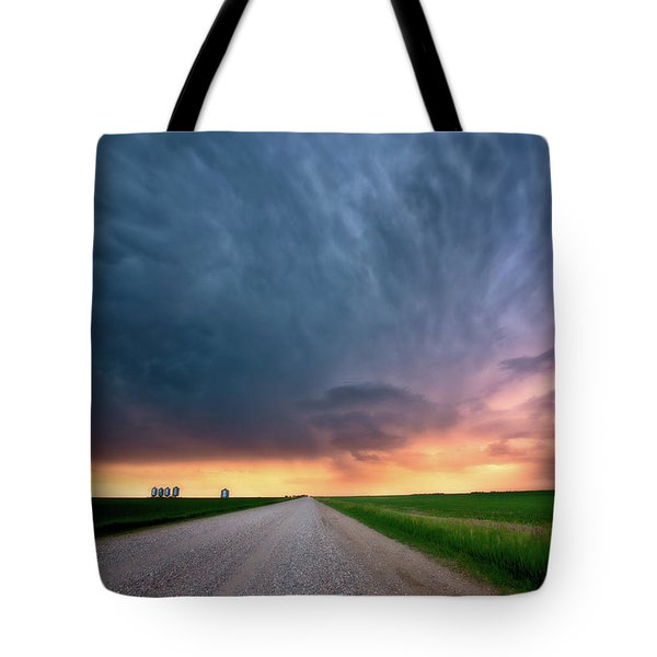 Storm Clouds Over Saskatchewan Country Road Tote Bag by Mark Duffy