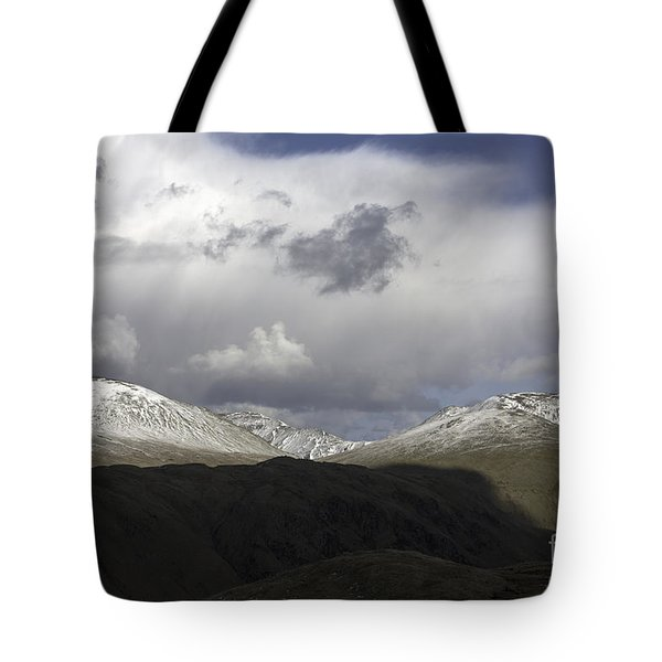 Storm Clouds Passing Across The Snow Covered Summits Of St Sunday Crag And Fairfiled Grasmere  Tote Bag