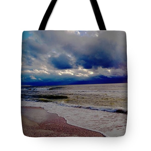 Tote Bag featuring the photograph Storm Clouds by Vicky Tarcau