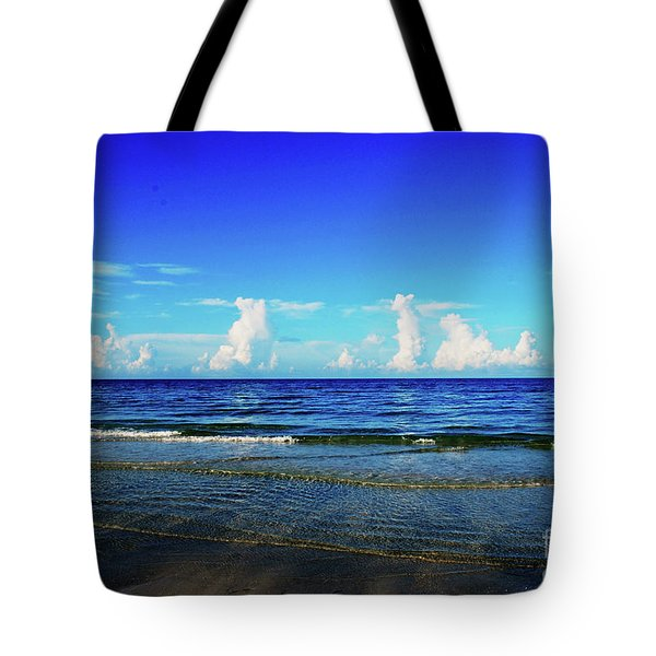 Tote Bag featuring the photograph Storm On The Horizon by Gary Wonning