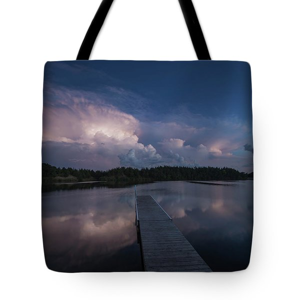 Tote Bag featuring the photograph Storm Reflection by Aaron J Groen