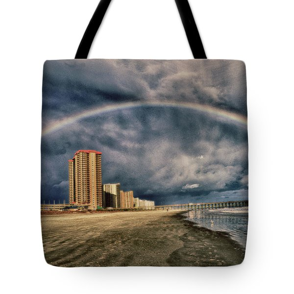 Tote Bag featuring the photograph Stormy Rainbow by Kelly Reber