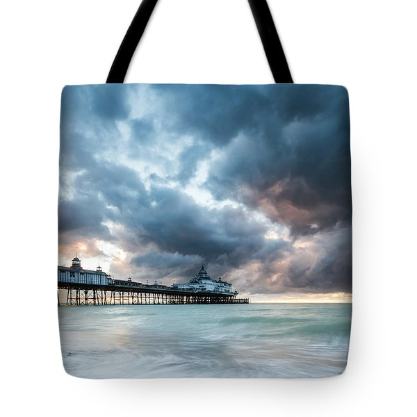 Stormy Sunrise Over Eastbourne Pier Tote Bag