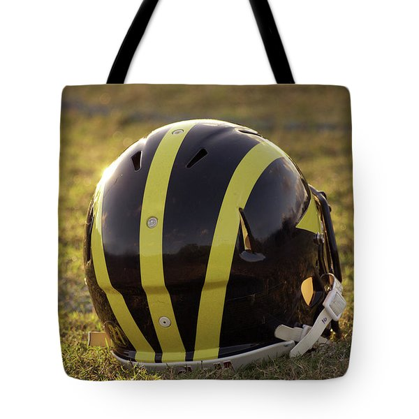 Striped Wolverine Helmet On The Field At Dawn Tote Bag