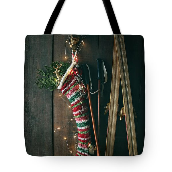 Striped Wool Stocking With Old Skis And Sparkling Lights Tote Bag
